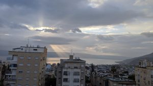 The Sunlight shines through the clouds on the sea of Galilee